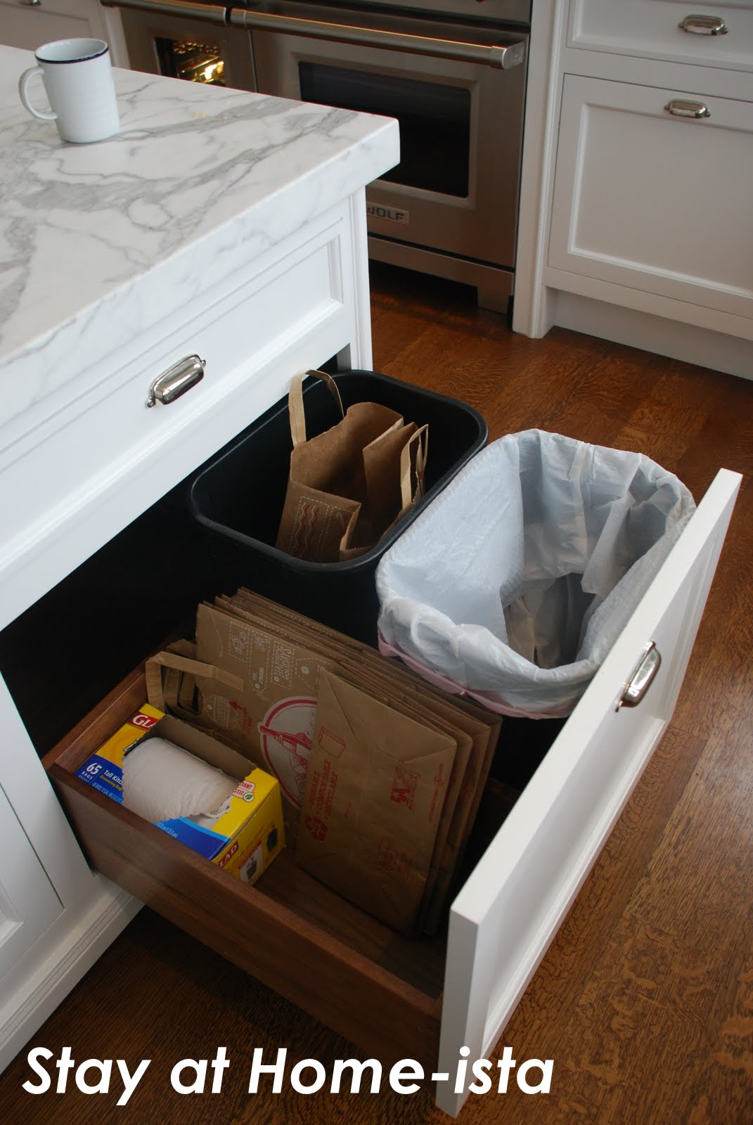 Hide Kitchen Trash Can Rustic Alder Cabinets Stay At Home Ista The Most Asked Party Question