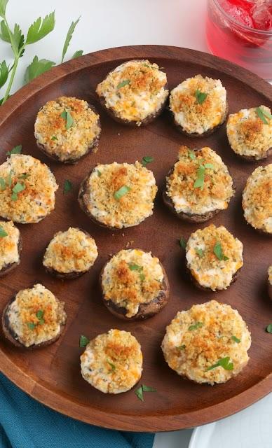 Cheesy Garlic Stuffed Mushrooms on wood platter from above