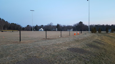 the dip in the outfield of the new softball field is being 'fixed' by  moving the fences in and shortening the outfield