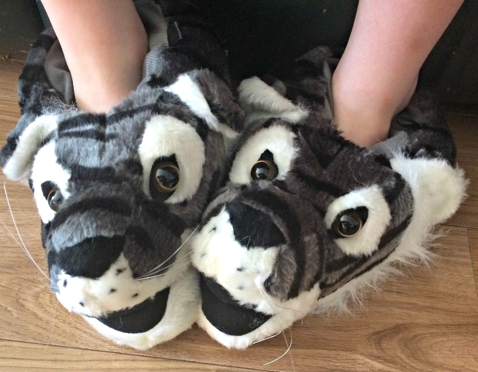 Ieuan wearing his tiger slippers from Wynsors