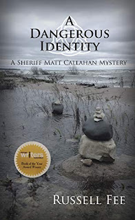 A Dangerous Identity: A Sheriff Matt Callahan Mystery by Russell Fee