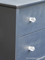 Clear glass knob on blue dresser