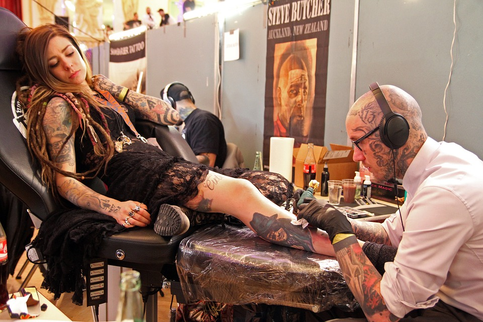Woman getting a tattoo