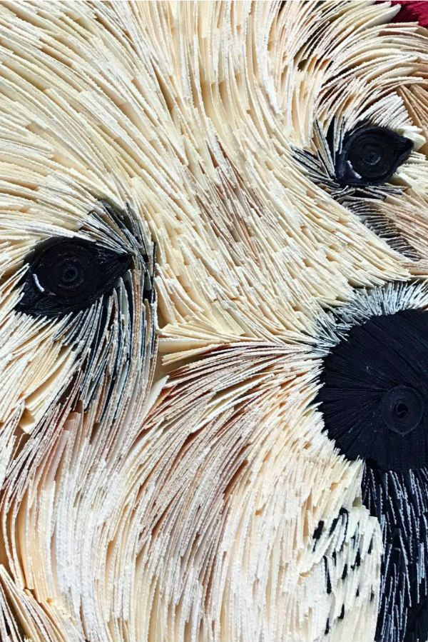detail of dog's face composed of tightly layered paper strips