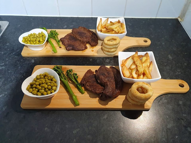 Steak date night at home, steak served on a wooden serving tray.