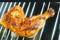 Tandoori chicken leg piece on bbq grill ( jali) for Tandoori chicken recipe on gas top