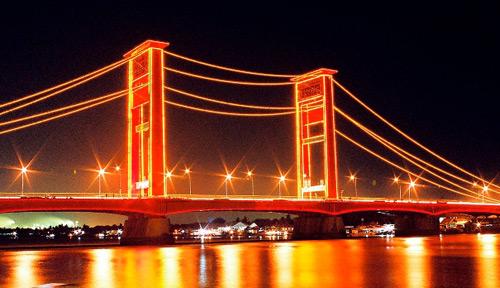 Ampera Bridge at Night : Landmark of Palembang City