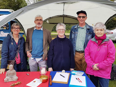 Five of the crew at the Warwick Triratna Buddhists stall
