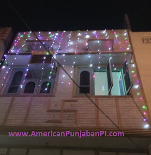 Gold Swastika on Home in Amritsar India with Diwali Lights