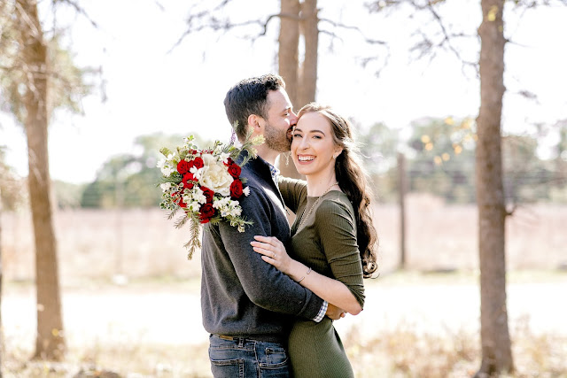 fall engagement photo with bouquet