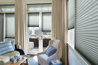 Hunter Douglas PowerView Motorization lets you automatically move shades like these Duette Honeycomb blinds up or down anytime from anywhere.