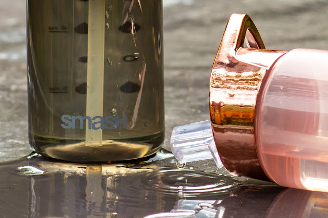 Close up of SMASH water bottles showing drinking spout