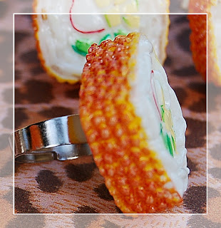 http://www.buzzfeed.com/sparklingbagcandydotcom/giant-sushi-ring-yes-its-jewelry-2env