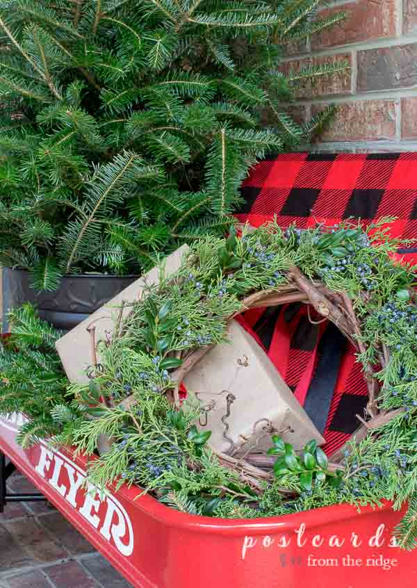 evergreen wreath in old red radio flyer wagon