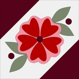 pink red and maroon rose on a quilt block