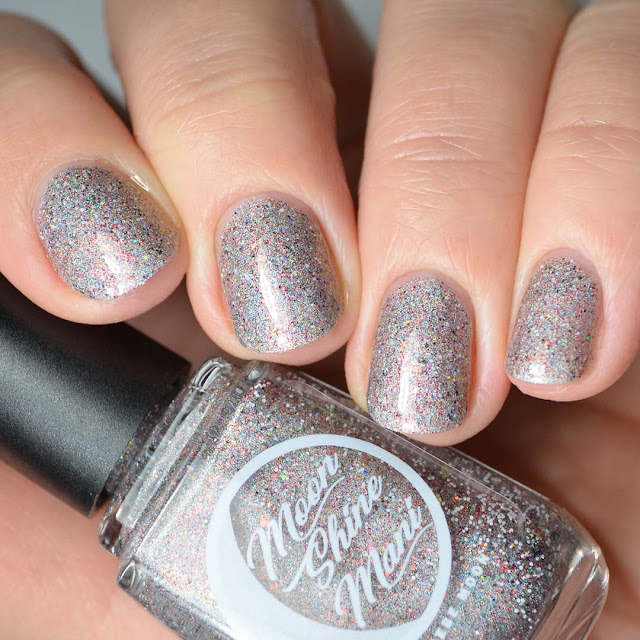 grey holographic nail polish with glitter swatch