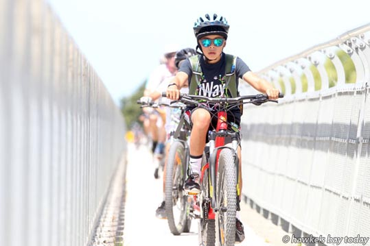 Khan Smith, 10, Napier, crossing Black Bridge, Haumoana, on the iWay Fun Ride, a Summer Cycling Carnival event.  photograph