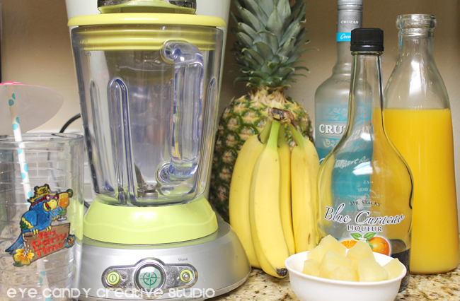 supplies needed to make a tropical drink, bananas, rum, blender