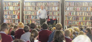 Bob Burke reads from 'The third pig detective agency' at Kilrush Library