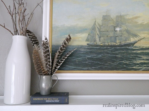 How to Decorate a Long Mantel: nautical, art, ship, feathers, book, white vase, sticks, branches, silver pitcher