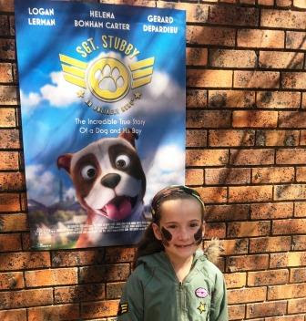 Girl in front of Sgt. Stubby poster