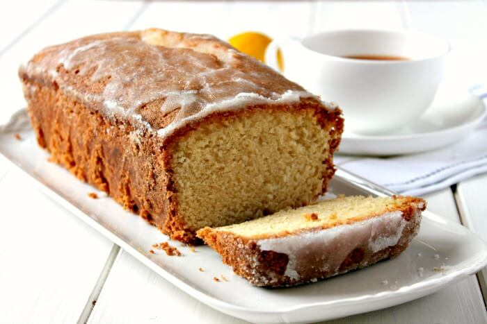 Lemon and Lime Drizzle loaf cake on serving plate