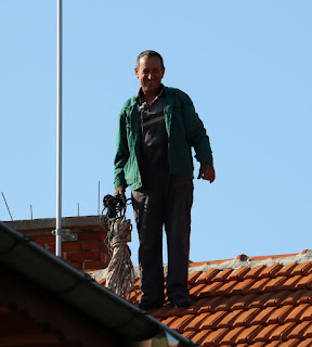 On the roof to clean the chimneys