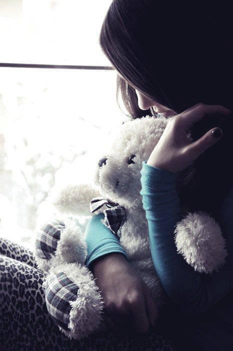 sad girl with teddy