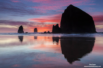 Sunset over Haystack Rock at Cannon beach on the Oregon Coast, Oregon, USA.