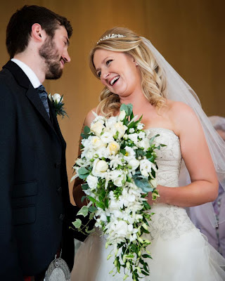 Bride and Groom sharing a tender moment, bouquet, tiara, wedding dress