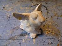 building in details on animal sculpture