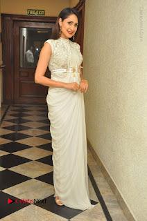Actress Pragya Jaiswal Stills in Beautiful White Dress at turodu Audio Launch  0072.JPG