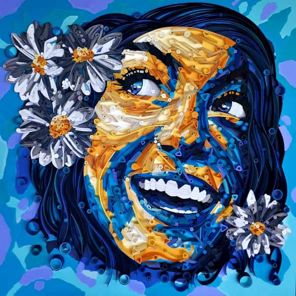 quilled paper portrait of smiling woman with flowers in hair