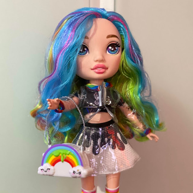 A Rainbow Surprise Slime Doll with rainbow hair and see through plastic jacket