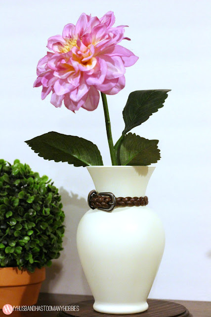 http://myhusbandhastoomanyhobbies.com/thrifty-dollar-store-vase-makeover/