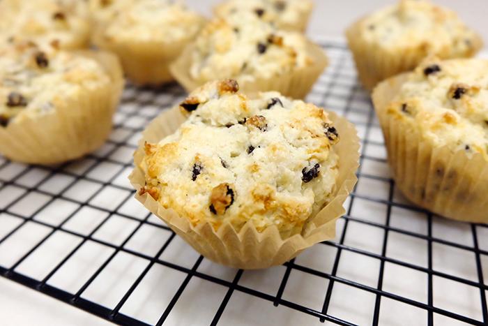 Irish soda bread muffins cooling on a rack