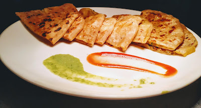 Garnished pieces of aloo paratha with sauce for aloo paratha recipe