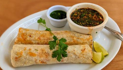Tacos de barbacoa enchilada with consomé