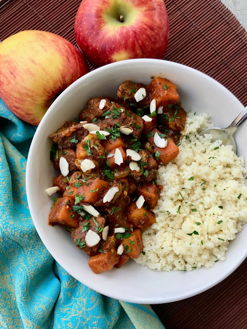Bowl of Moroccan apple and sweet potato beef stew with couscous.