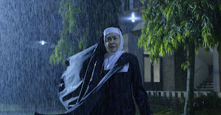 Scary nun in the rain