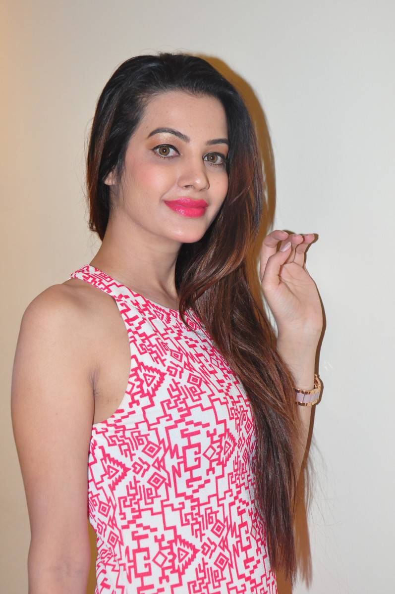 Actress Deeksha Panth Long Hair Stills In Pink Dress