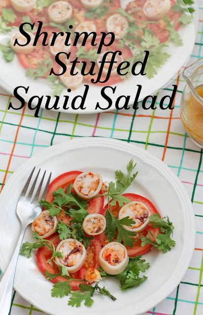 Food Lust People Love: Spicy shrimp stuffed squid salad says it all. Shrimp, chili peppers, garlic and cheese are stuffed into clean squid and baked! Once sliced, these beauties make a tasty colorful addition to a fresh tomato salad. This salad looks fancy, if you have special guests that need impressing, but it's really quite easy to make.