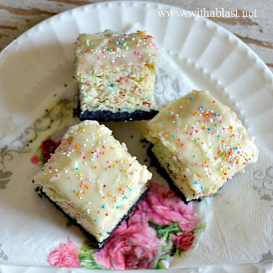 Gooey Oreo crust with a soft Funfetti cake topping, {made from a cake mix} and frosted with a creamy White Chocolate Cream Cheese Frosting ! Superb sweet treat #CakeMixRecipe #FunfettiCake www.WithABlast.net
