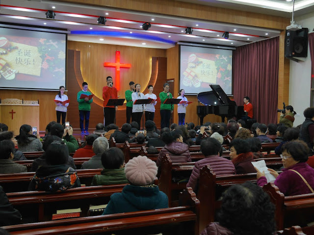 youth singing inside a church in Wenzhou, China