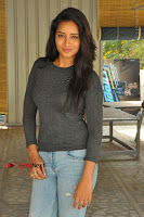 Actress Bhanu Tripathri Pos in Ripped Jeans at Iddari Madhya 18 Movie Pressmeet  0071.JPG