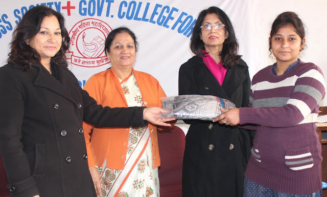 Distributed sweaters to students of State Women's College Faridabad