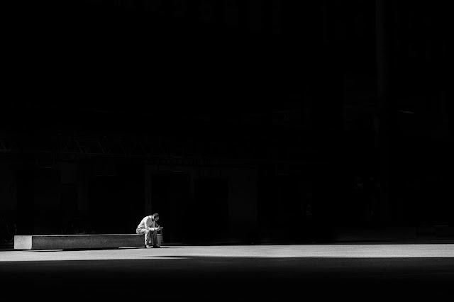 https://www.pexels.com/photo/man-sitting-on-a-concrete-bench-373914/