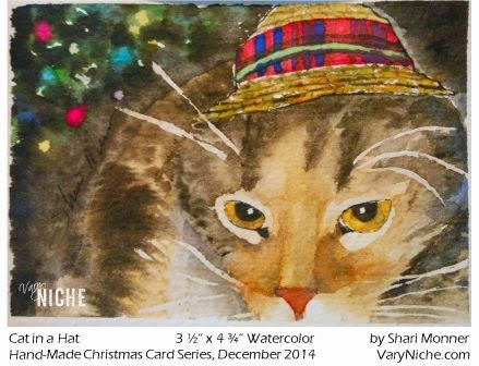 Watercolor Painting of a Calico Cat in front of a Christmas Tree. by Shari Monner, VaryNiche.com