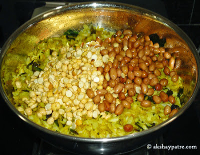 fried putanis and peanuts added to poha