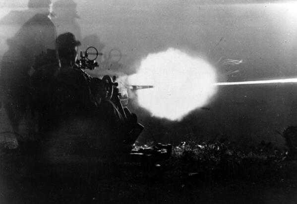 Germany soldiers in action with a 20mm anti-aircraft gun FlaK 30, against Allied troops in Italy, 1943.